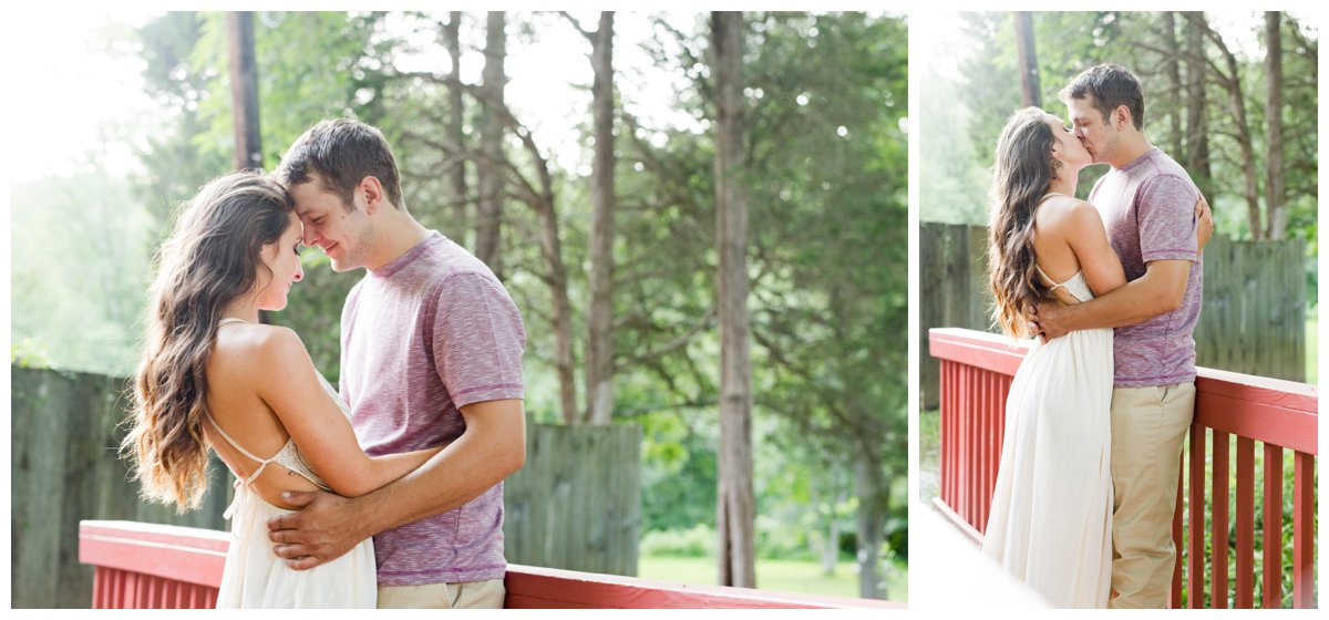 Jerusalem Mills Bohemian Engagement Photography in a white dress while on a red walking bridge.