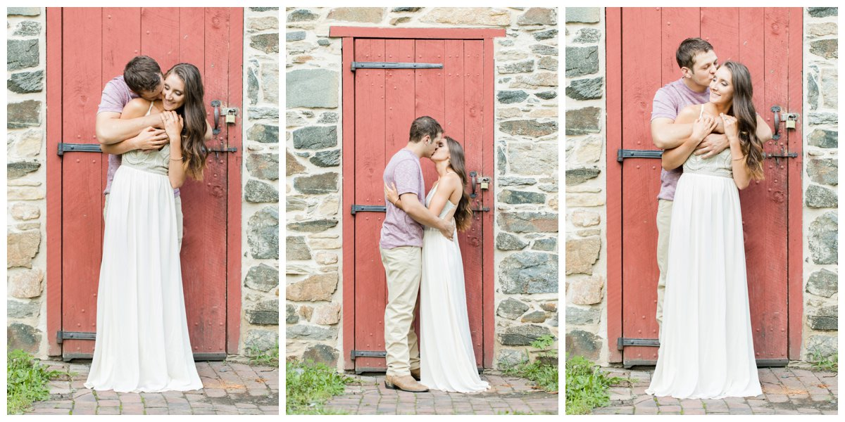 Jerusalem Mills Bohemian Engagement Photography in a white dress against a red barn door.