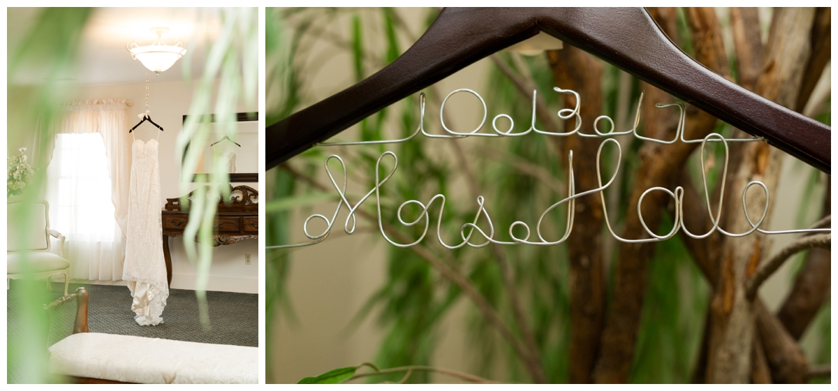 Bride's dress on a mirror with a tree and handmade hanger with married name and wedding date
