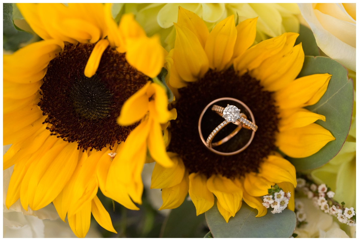 Rose Gold engagement ring and wedding bands on sunflower bouquet