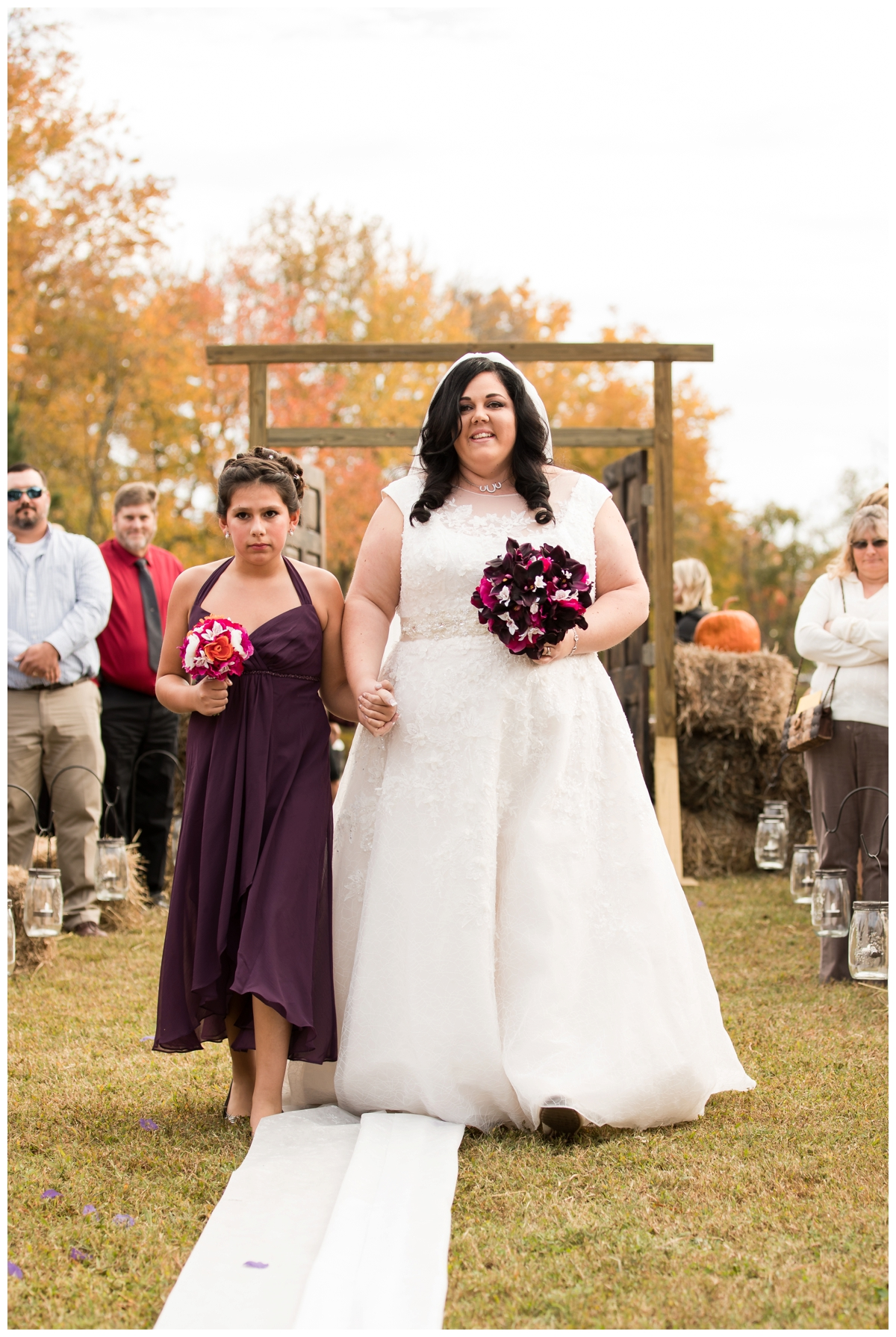 Bride being walked down the aisle by her daughter