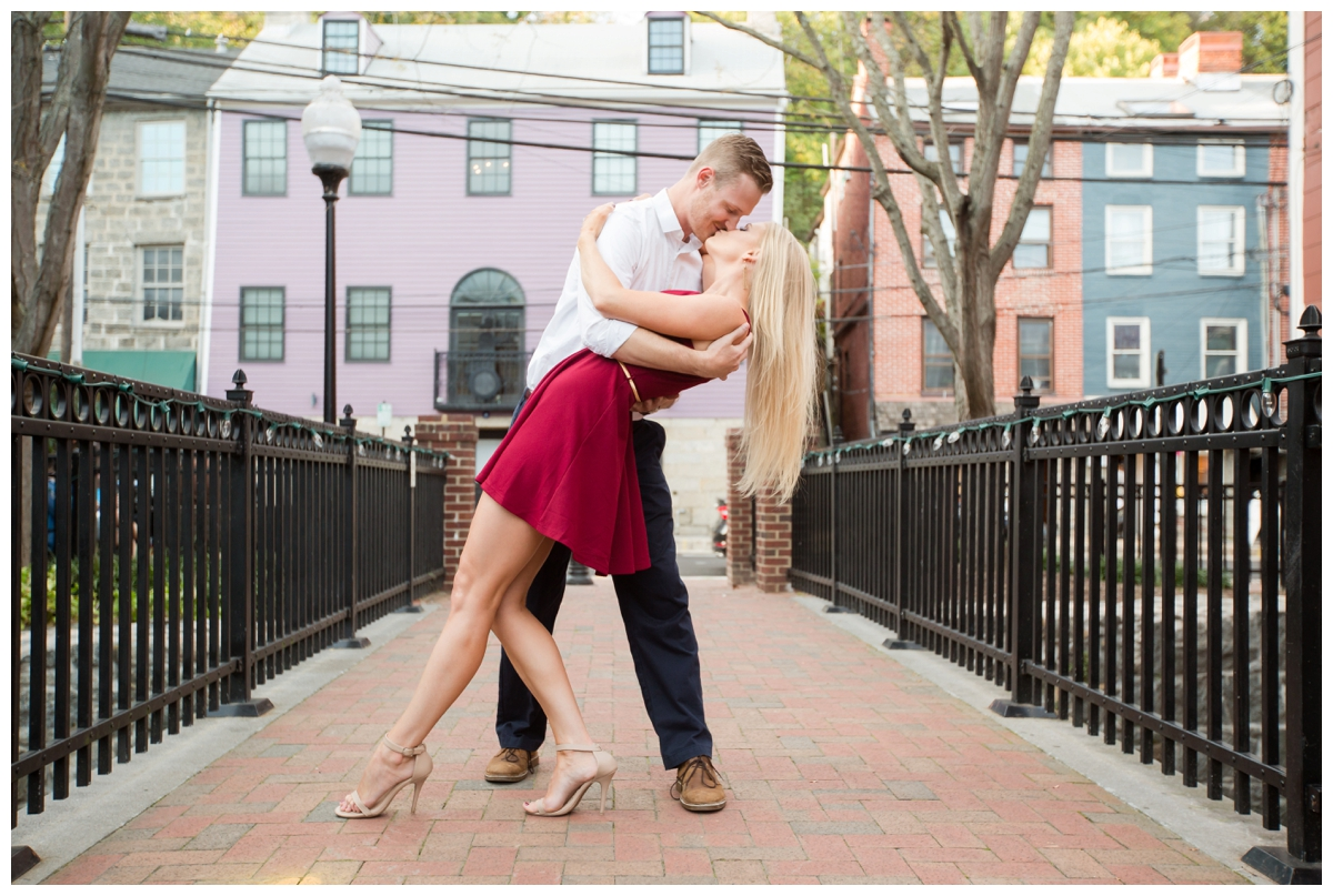 Ellicott City Engagement Photo by train bridge. Old Ellicott City. Dipping his bride to be.