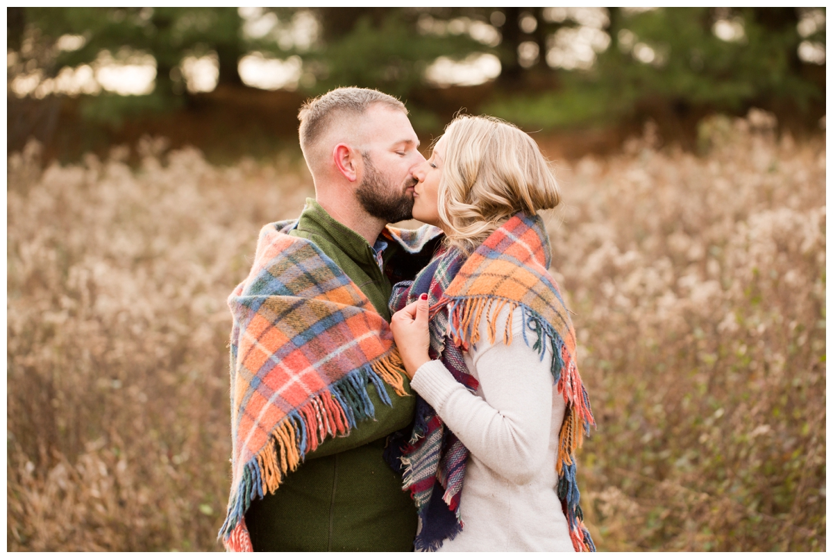 Fall Lake Hashawa engagement session. Couple wrapped in blanket