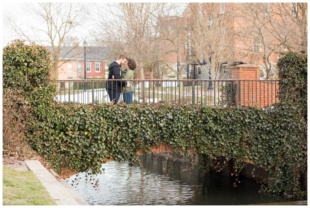 Engaged Couple with Disney Themed Frederick Maryland Engagement Photos on bridge