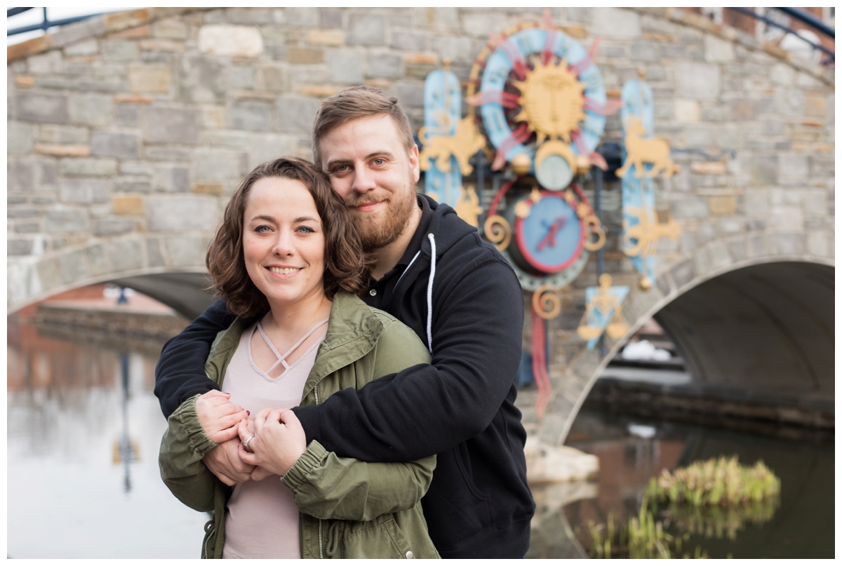 Engaged Couple with Disney Themed Frederick Maryland Engagement Photos by the bridge