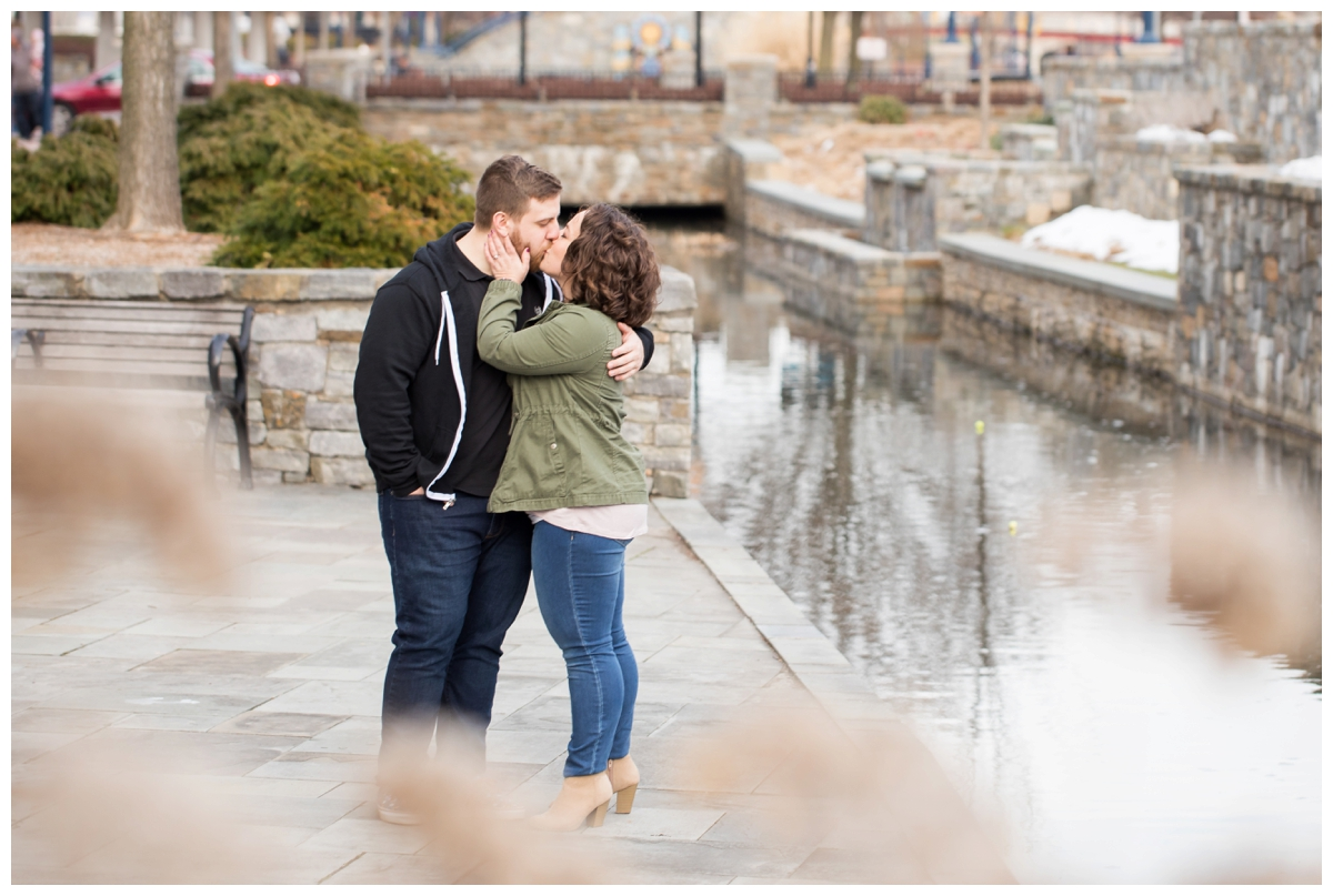 Engaged Couple with Disney Themed Frederick Maryland Engagement Photos by the canal
