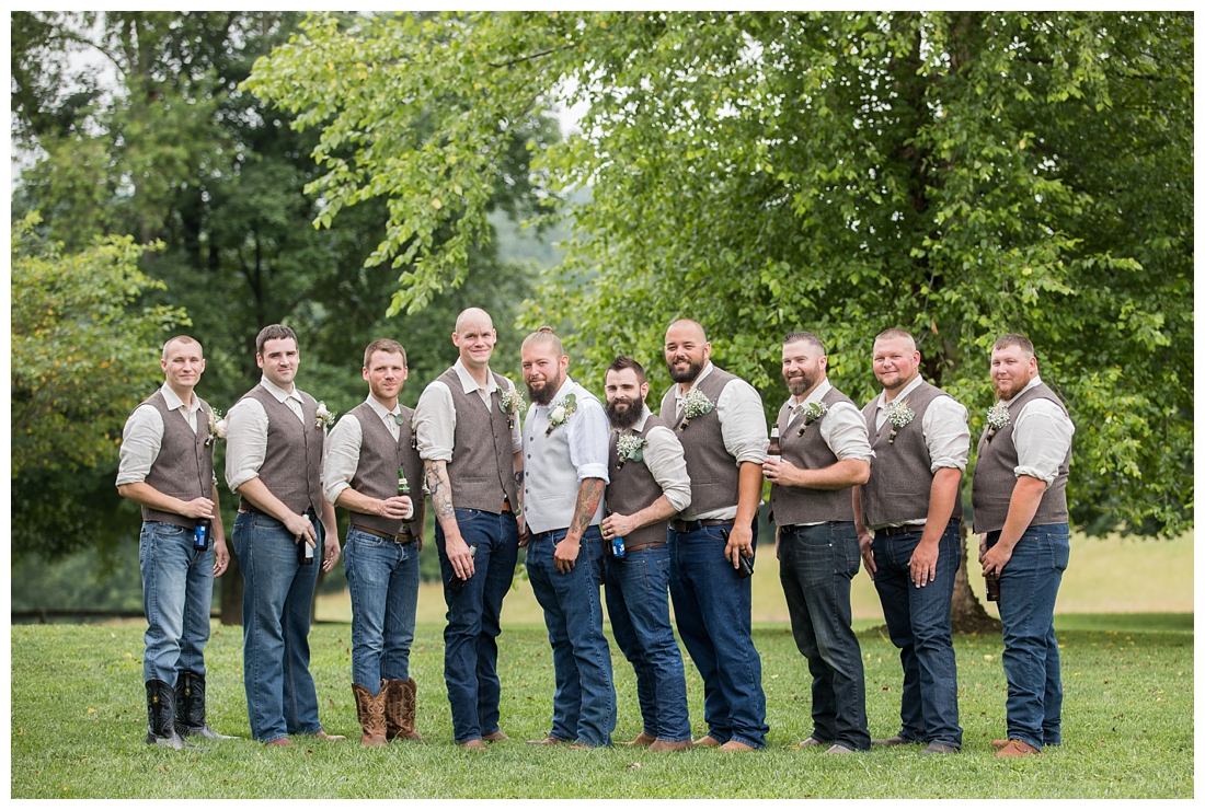 Groomsmen posing in blue heans, cowboy boots and a brown vest. Maryland wedding at Circle D Farm in Woodbine. Maryland Wedding Photographer