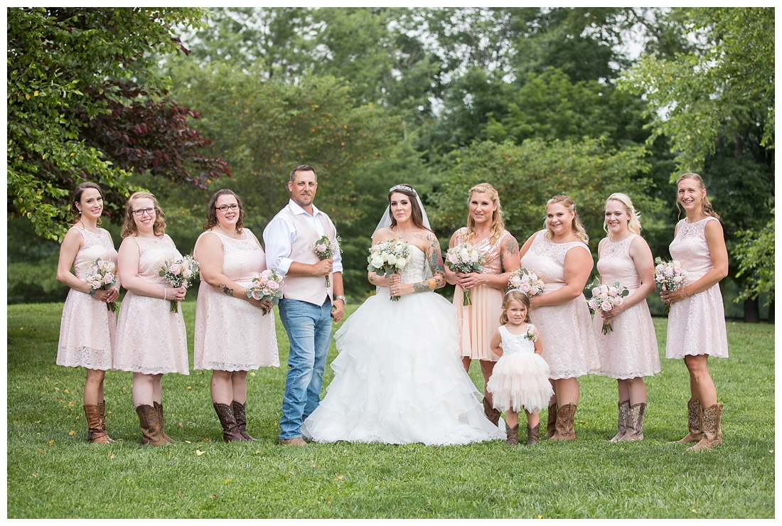 Bridal party posing in dusty rose bridesmaid dresses and rose bouquets. Bridesman with bouquet. Maryland wedding at Circle D Farm in Woodbine. Maryland Wedding Photographer