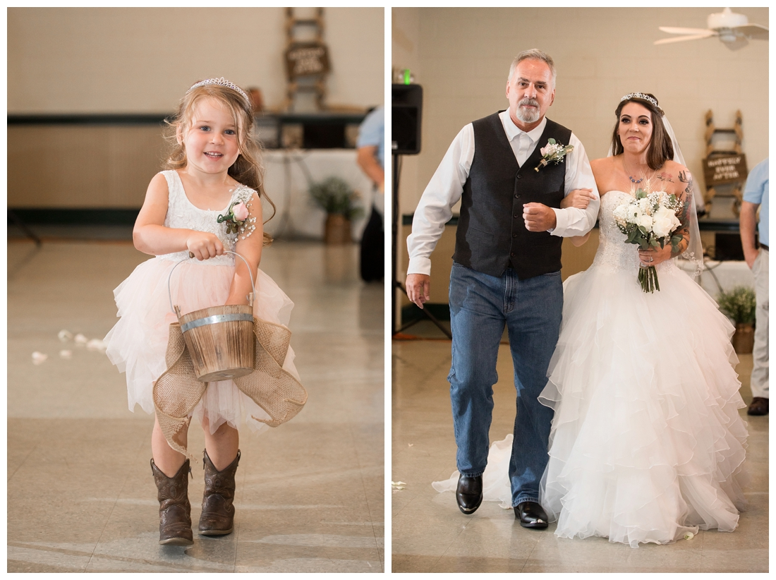 Indoor wedding ceremony. Flower girl in cowgirl boots. Bride and her father in the aisle. Maryland wedding at Circle D Farm in Woodbine. Maryland Wedding Photographer
