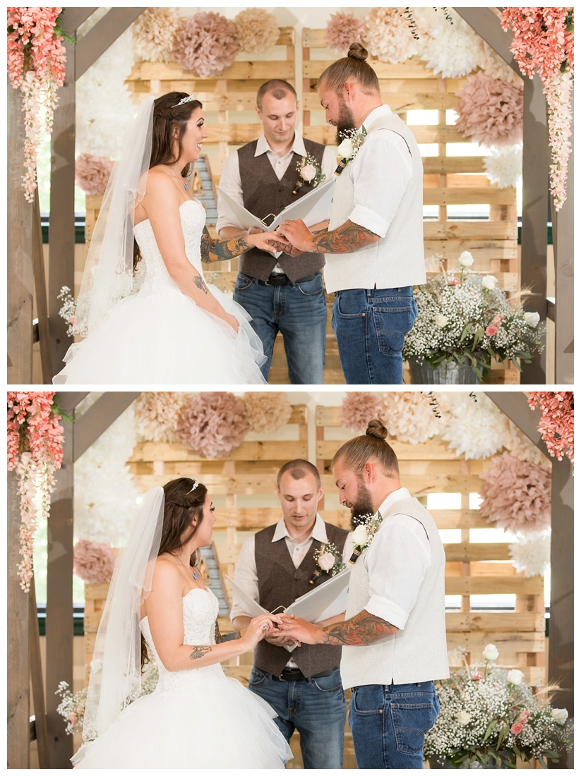 Indoor wedding ceremony. Rustic Wedding Decor. Rose Gold wedding decor. Wooden arbor with flowers. Maryland wedding at Circle D Farm in Woodbine. Maryland Wedding Photographer.Bride and Groom exchanging rings.