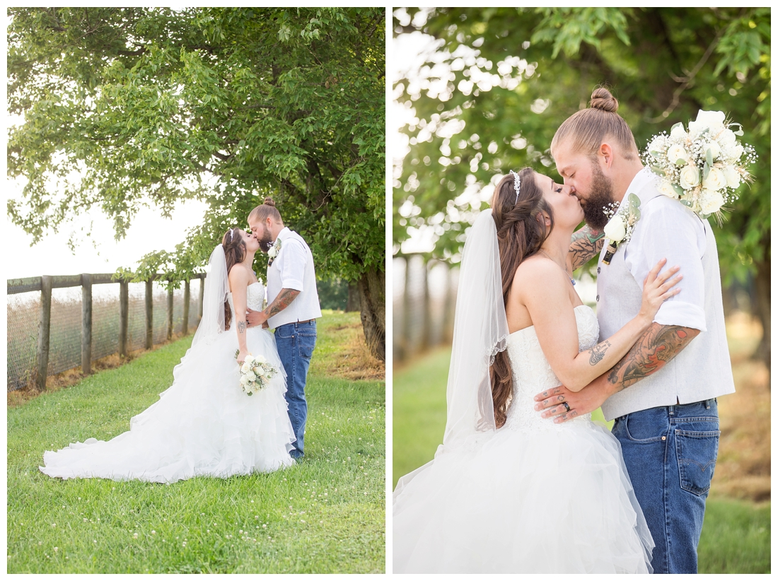 Outdoor bride and groom portraits. Bride and groom kissing under a tree. Maryland wedding at Circle D Farm in Woodbine. Maryland Wedding Photographer.