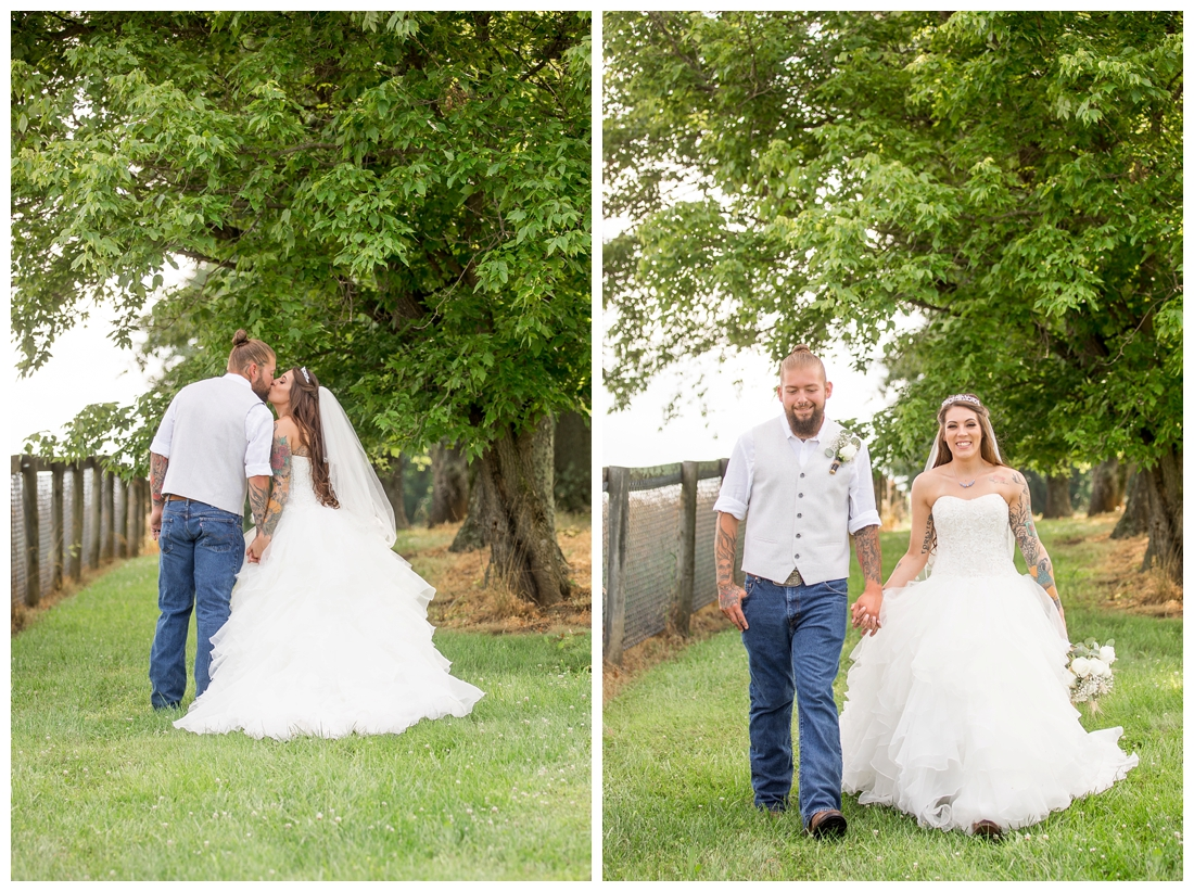 Outdoor bride and groom portraits. Bride and groom kissing under a tree. Maryland wedding at Circle D Farm in Woodbine. Maryland Wedding Photographer. Bride and Groom kissing and walking