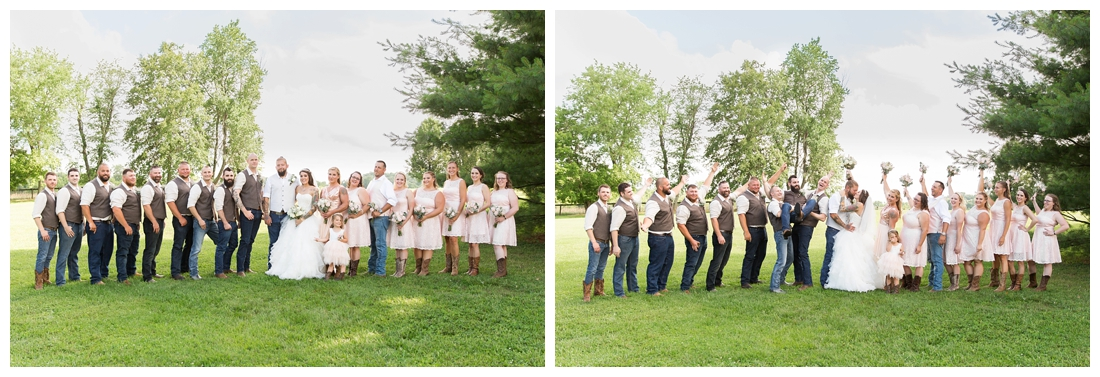 Full bridal party celebrating the newlyweds in a field. Maryland wedding at Circle D Farm in Woodbine. Maryland Wedding Photographer.