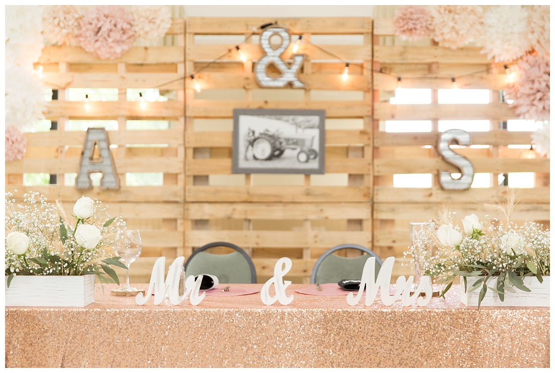 Reception details and decor. Rustic wedding decor. Rose gold wedding decor. Sweetheart table. Wedding Pallet Wall. Maryland wedding at Circle D Farm in Woodbine. Maryland Wedding Photographer.