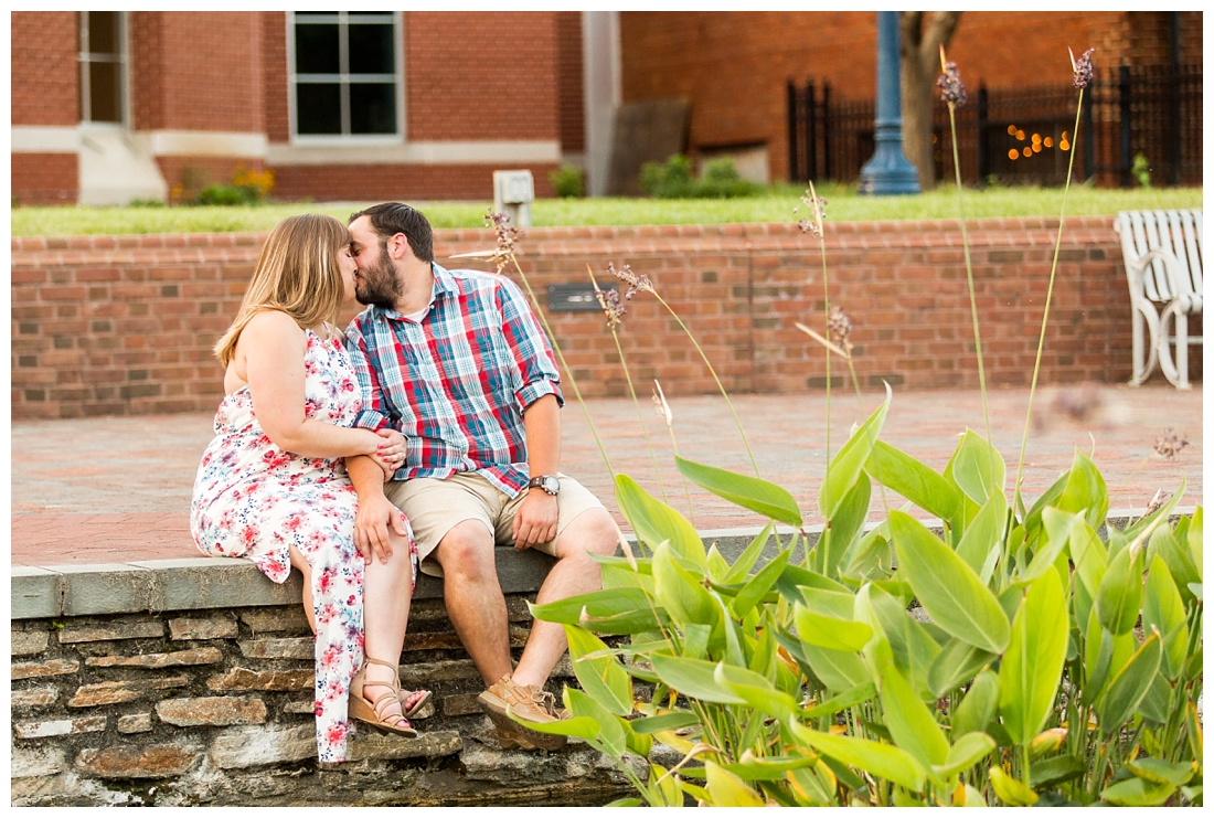 Engaged Couple. Downtown frederick engagement photos. Floral engagement session. Carroll Creek engagement photos. Engagement by the water. Bridge engagement photos. Engagement photo ideas.