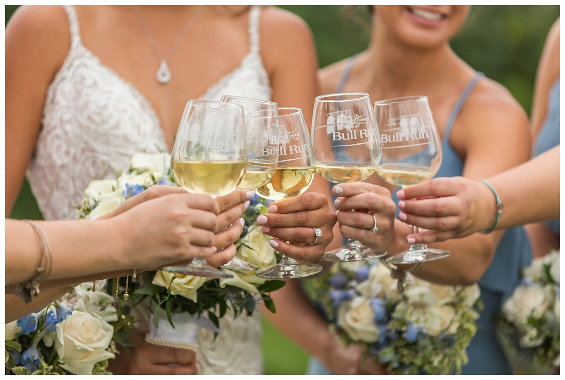 Winery at Bull Run Virginia Wedding. Bride and Groom married ar ruins in vineyards. Dusty Blue and Navy Wedding. cheers wine glasses