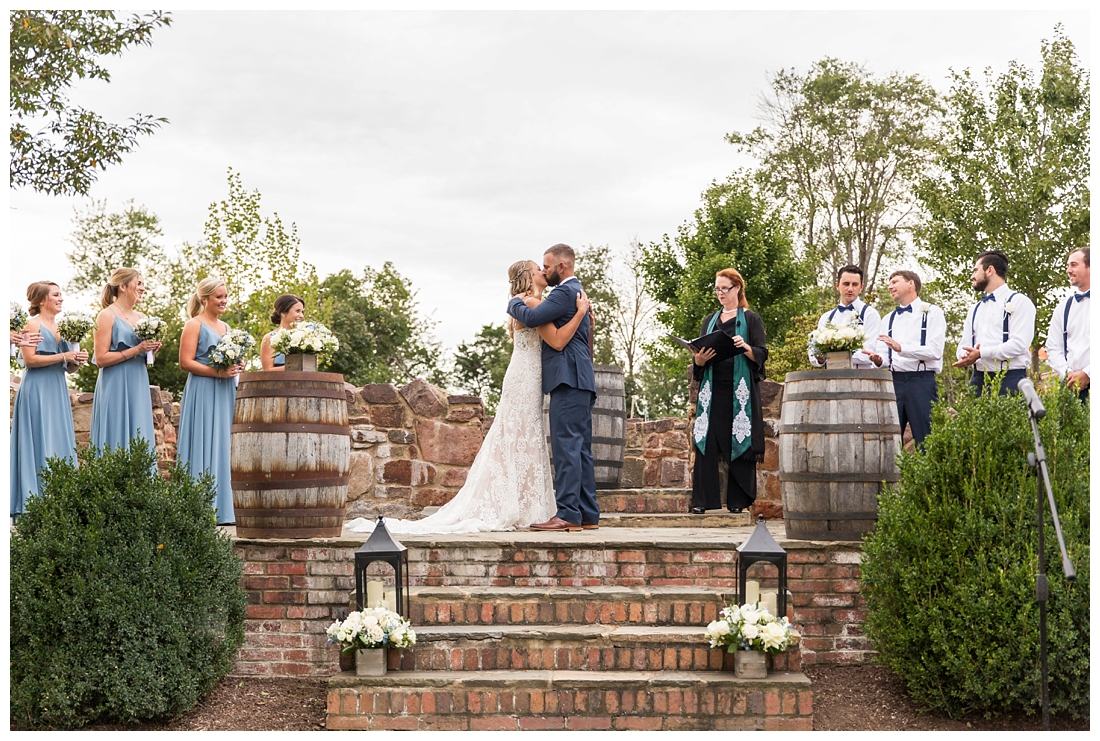 Winery at Bull Run Virginia Wedding. Bride and Groom married ar ruins in vineyards. Dusty Blue and Navy Wedding. First kiss
