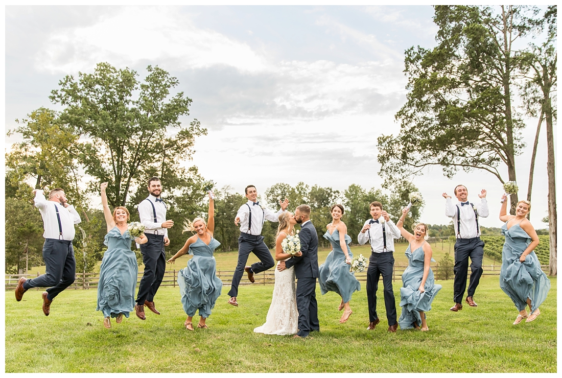 Winery at Bull Run Virginia Wedding. Bride and Groom married ar ruins in vineyards. Dusty Blue and Navy Wedding. Bridal party jumping photo