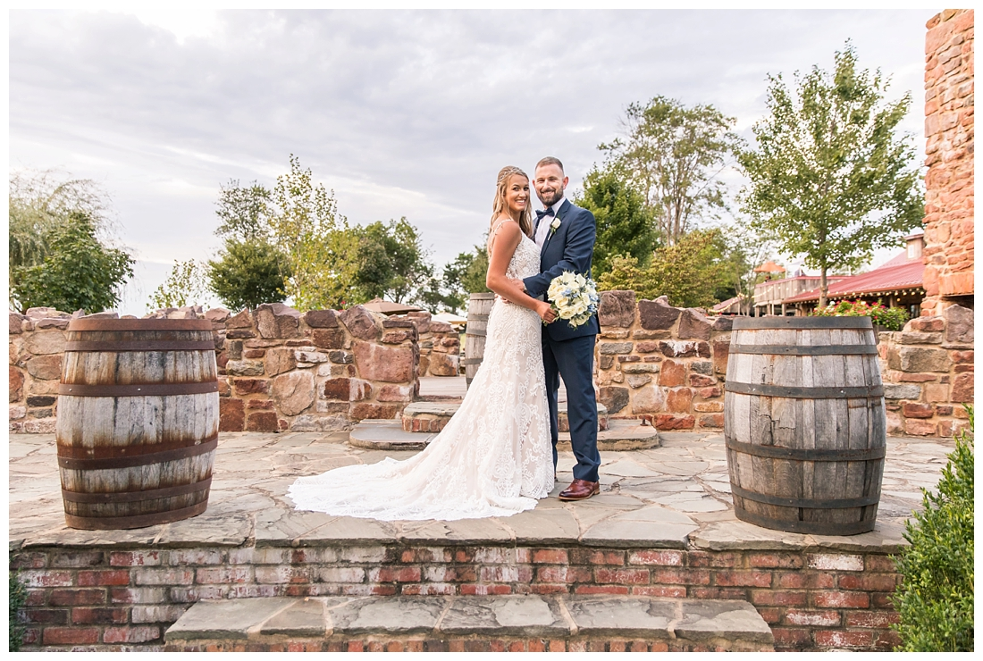 Winery at Bull Run Virginia Wedding. Bride and Groom married ar ruins in vineyards. Dusty Blue and Navy Wedding. Just married portraits on the ruins