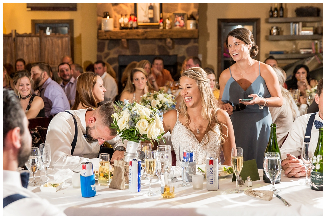 Winery at Bull Run Virginia Wedding. Bride and Groom married ar ruins in vineyards. Dusty Blue and Navy Wedding. Maid of honor toast bride and groom laughing