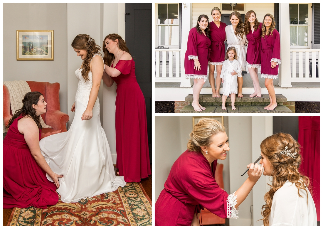 Frederick Maryland McClintlock Distillery Wedding. Frederick Wedding. Distillery Wedding. Cottage getting ready. Air bnb wedding day. Burgundy and Navy wedding color scheme. Bride putting on wedding dress. Bridal party robes. Burgundy Robe.
