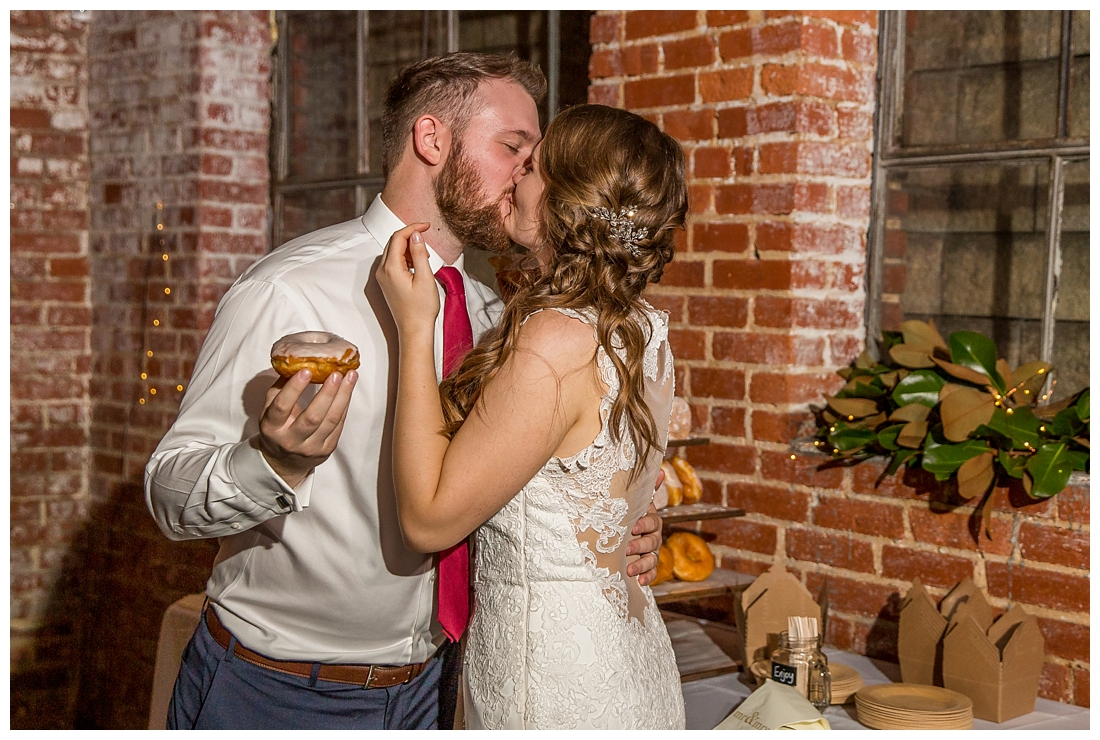 Frederick Maryland McClintlock Distillery Wedding. Frederick Wedding. Distillery Wedding. Cottage getting ready. Air bnb wedding day. Burgundy and Navy wedding color scheme. donut smashing wedding donuts.