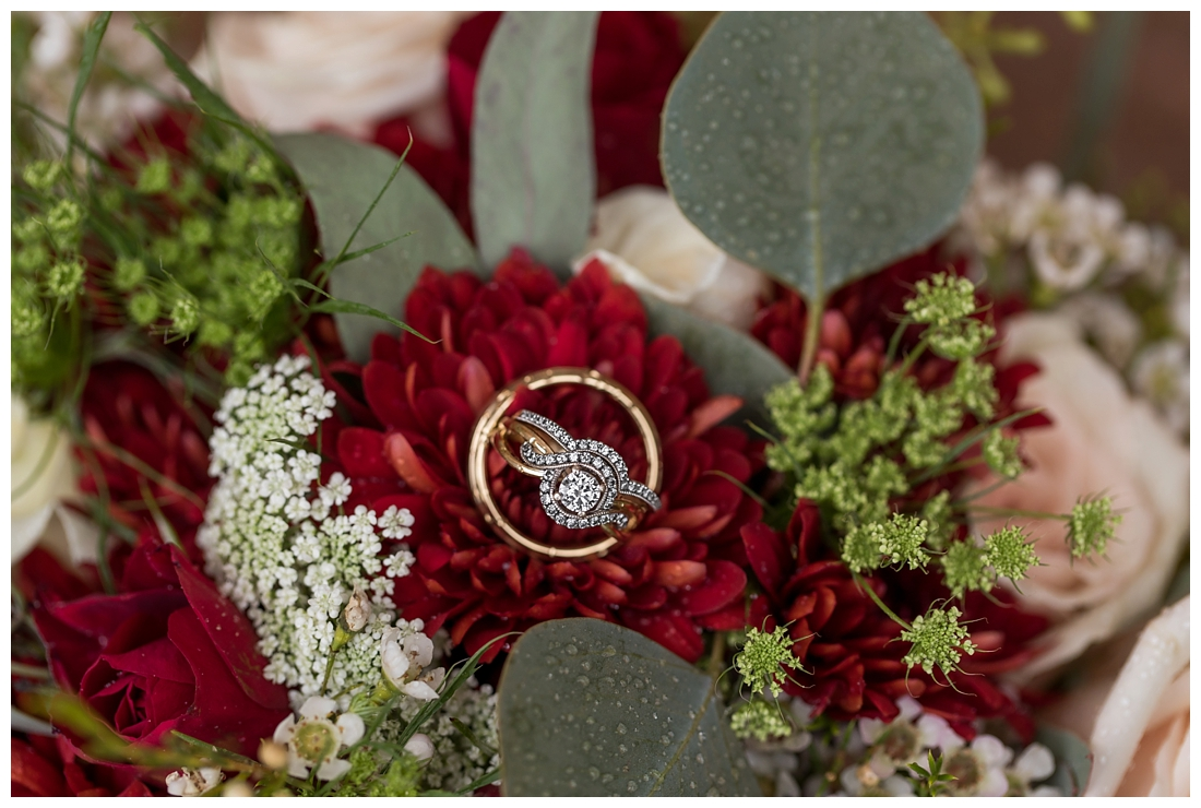 Vineyards of Marys Meadow Wedding in Darlington Maryland. Rainy fall wedding. Cold wedding day. Rainy wedding day. maryland wedding photographer. Barn wedding. Farm Wedding. wedding rings on bride's fall burgundy bouquet.