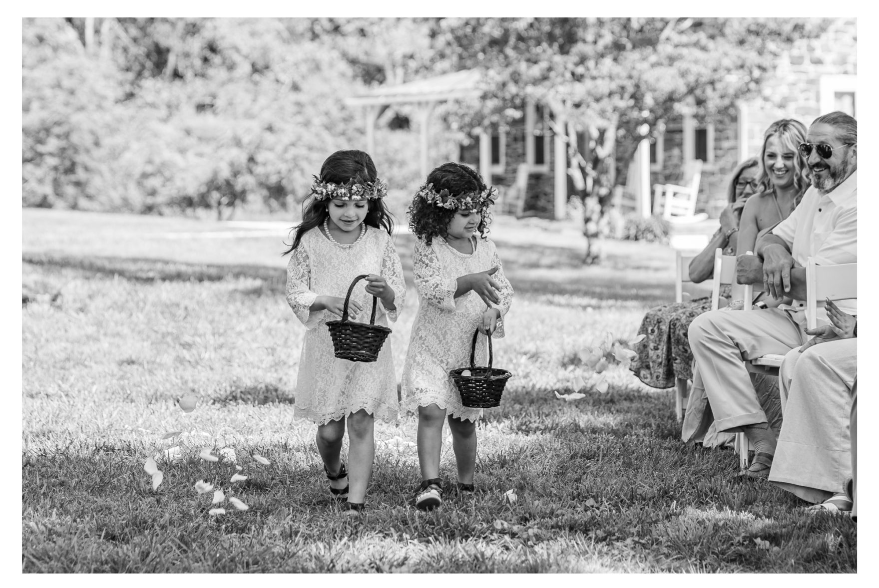 Summer wedding at a private residence farm in Westminster Carroll County Maryland. Cicadas, cows and dogs at the wedding. Pond view ceremony flower girls